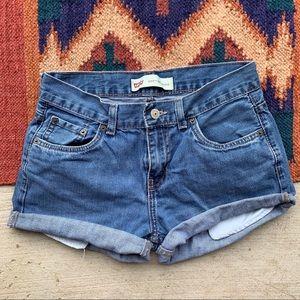 Levi's • mid waist cut off shorts. Size 25